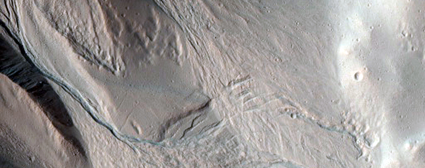 Well-Preserved 6-Kilometer Diameter Impact Crater with Gullies