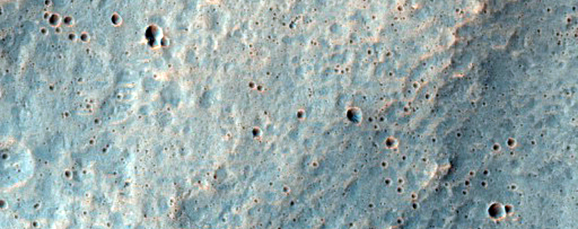 Ramparts of Layered Ejecta from Impact Crater in Hesperia Planum
