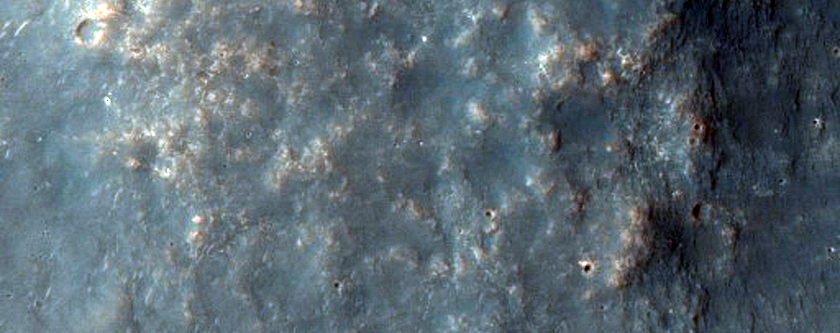Crater in Terra Sirenum with Possible Al-OH