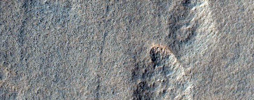 Incipient Scalloped Terrain in Mid-Latitude Mantle at Peneus Patera