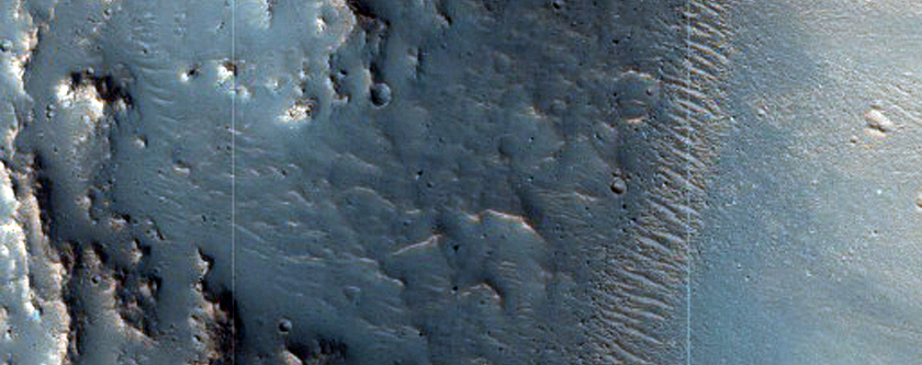 Layering in Crater Wall on Kasei Valles Floor