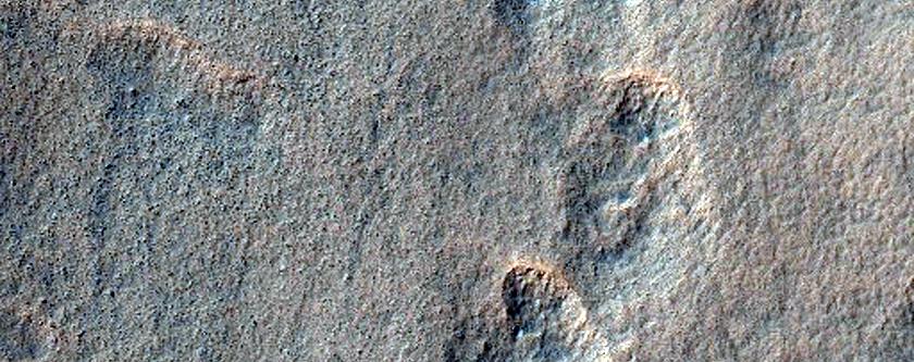 Incipient Scalloped Terrain in Mantle at Peneus Patera