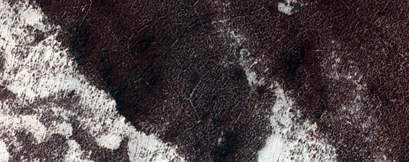 Circular Feature within South Polar Layered Terrain Scarp