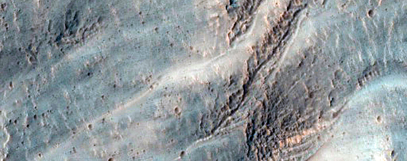 Gullied 35 Kilometer Diameter Impact Crater in Promethei Terra