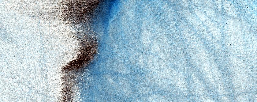 Raised Surface Deposit in Sisyphi Planum