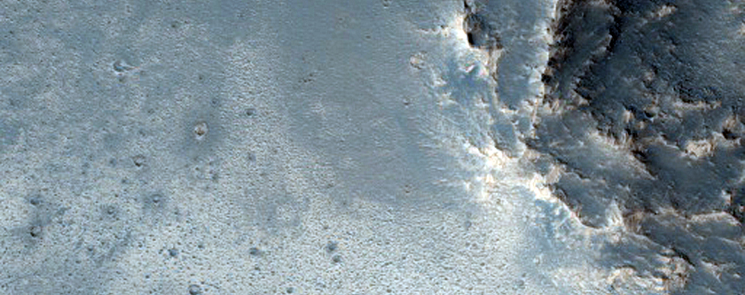 Crater Intersecting Wrinkle Ridge