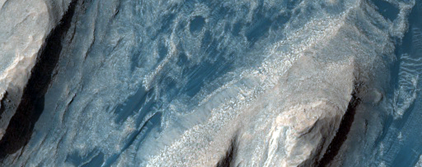 Light-Toned Rock Outcrops and Aeolian Dunes in Trouvelot Crater