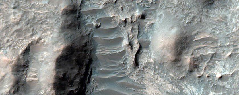 Remnant Mantiling Deposit in Millochau Crater