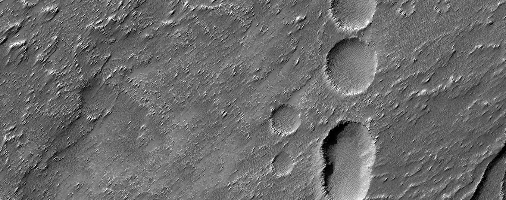 Chain of Pits Southwest of Arsia Mons