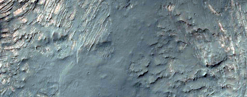Intact Layered Rocks Uplifted in Unnamed Crater Off of Solis Dorsa