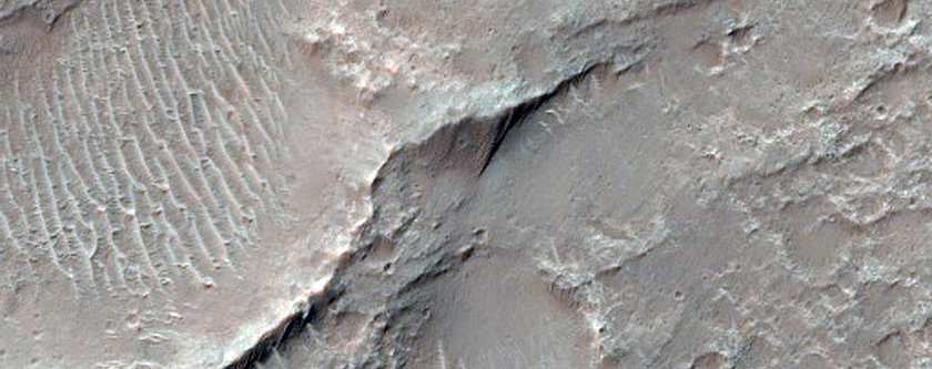 Linear Dunes and Sand Sheets in Herschel Crater