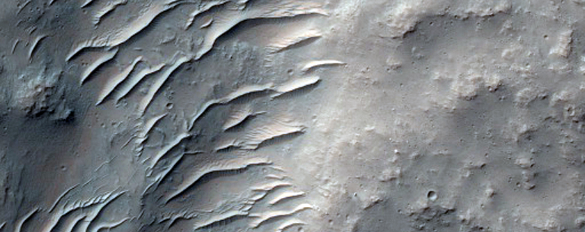 Channel Leading Into Small Impact Crater