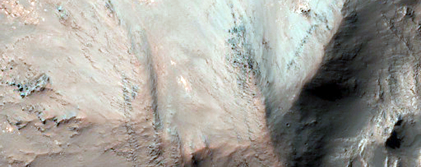 Central Structure and Layered Bedrock in 25-Kilometer Diameter Crater