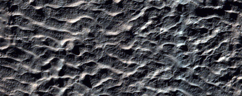Mound of Material in Crater Southwest of Newton Crater