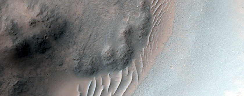 Crater in Tyrrhena Terra with Potential Phyllosilicates