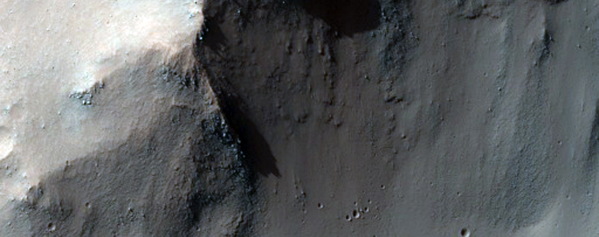 Impact Crater Teetering on the Edge of a Canyon