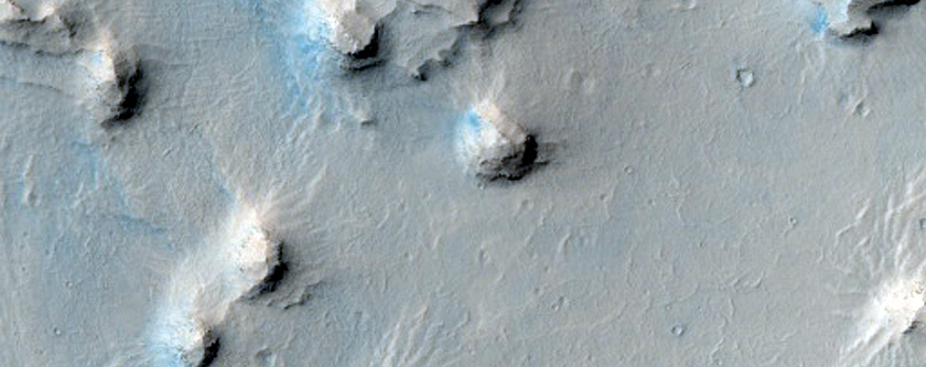 Layered Deposits in Crater in Western Arabia Terra