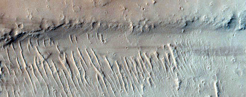 Lava Flow and Pit Craters Beween Ceraunius Fossae and Ascraeus Mons