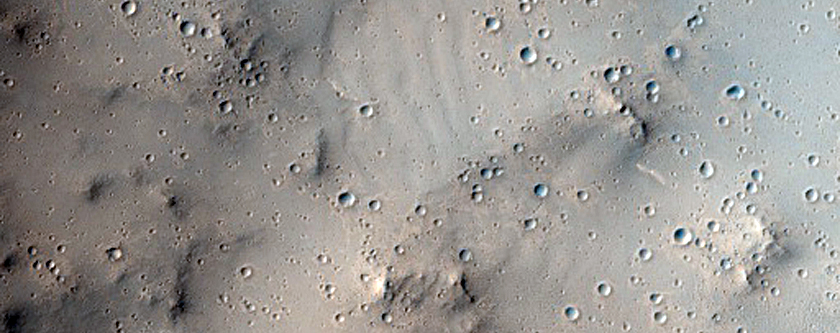 Isolated Tail of Dark Material Beyond a Crater