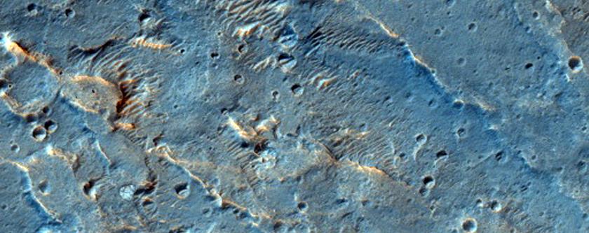 Thermally-Distinct Material at Distal Coogoon Valles