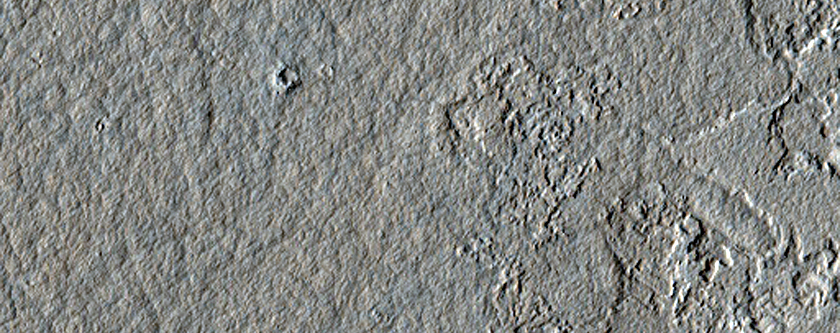 Decameter-Scale Patterned Ground and Possible Pits