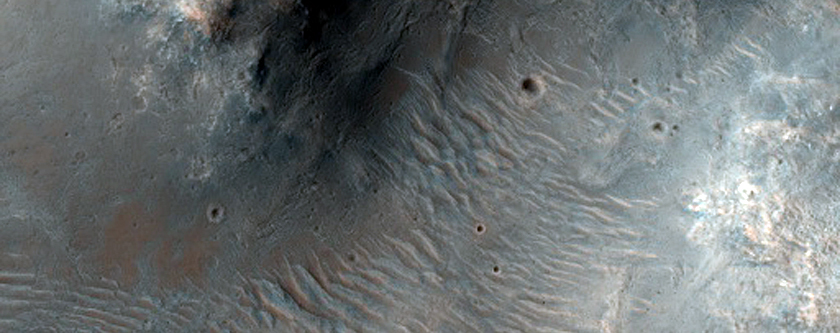 Possible Phyllosilicates Exposed by Small Impact in Tyrrhena Terra