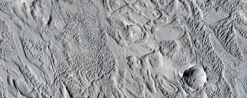 Crescent-Shaped Forms in Crater Fill Material