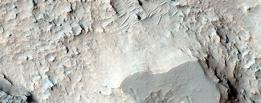 Pit on Floor of Niesten Crater that Exposes Layered Deposits