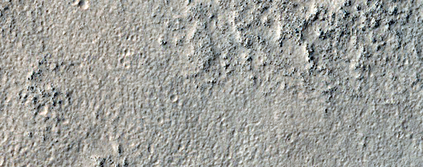 Layered Deposit in Craters along Reull Vallis