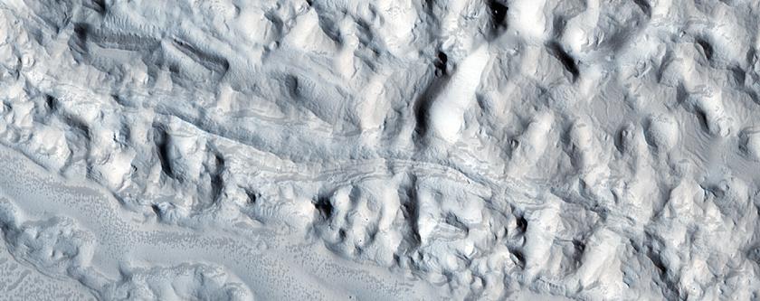 Eroded Crater Deposit in the Eastern Arabia Region