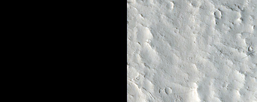 Crater Interior with Fans and Landslides and Yardangs