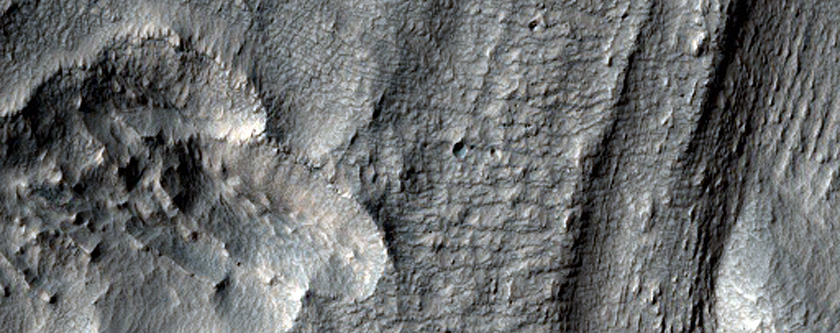 Material Flowing Through Gap in Crater Rim East of Hellas Planitia