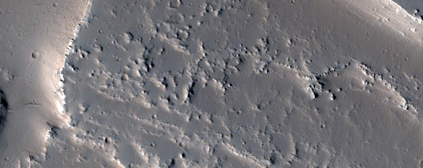 Channels and Lava Flows on the Tharsis Plateau