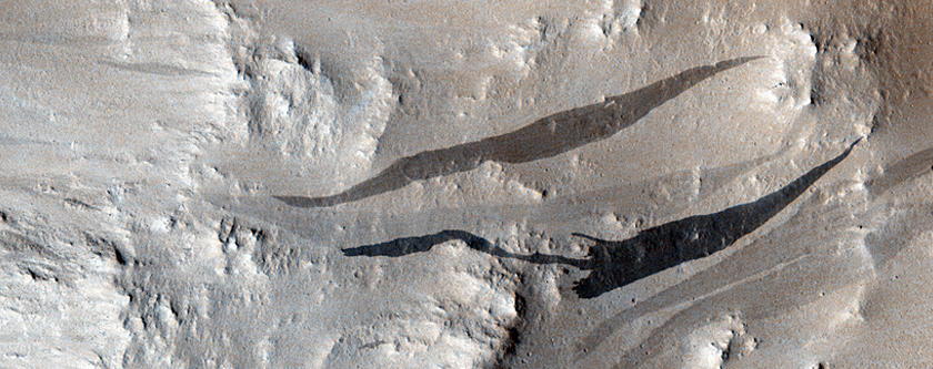 Ponded Lava, Slope Streaks, and Inadvertent Change Detection