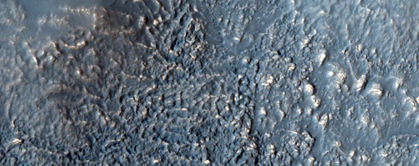 Possible Olivine-Rich Terrain in Thaumasia Region Highlands
