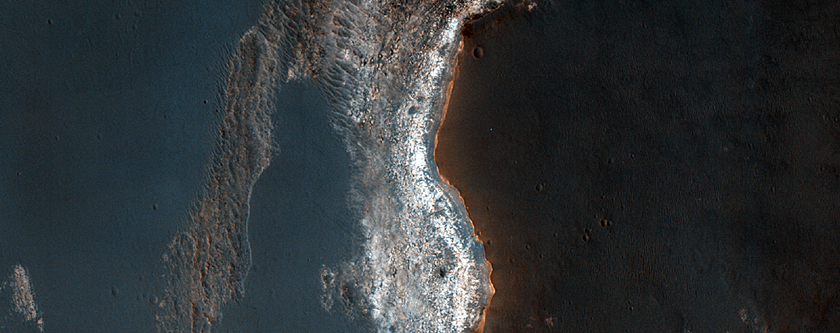 Light-Toned Sedimentary Rocks Exposed in Syrtis Major Region Scarp