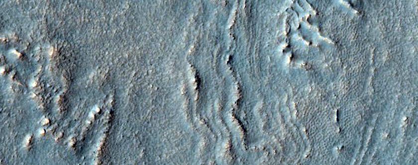 Crater in Thaumasia Fossae