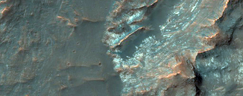 Central Pit of an Impact Crater with Layered Bedrock