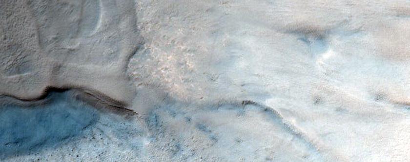 Crater with Material on Floor near Argentea Planum