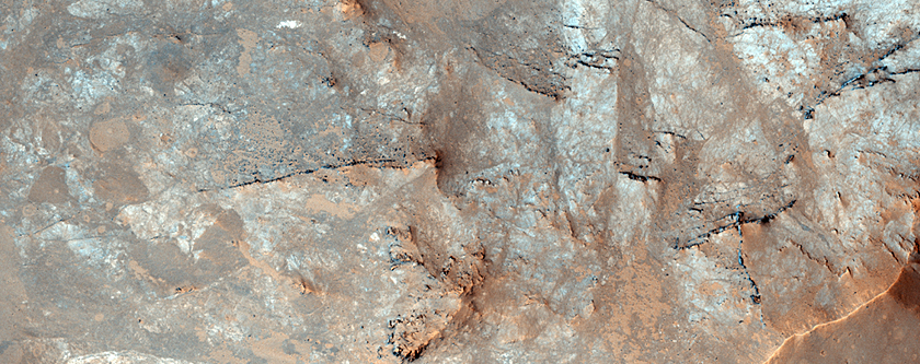 Uplifted Rocks in a Crater Center