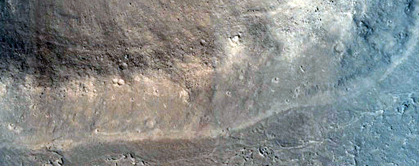 Plains-Forming Flow and Associated Trough Cut in Crater Wall