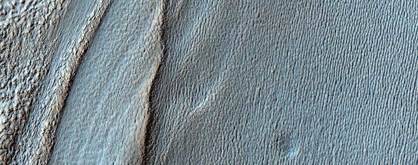 Lobate Flow Features in the Northwest Hellas Rim