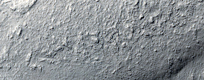 Tongue-Shaped Flow Feature on Mound in Terra Cimmeria