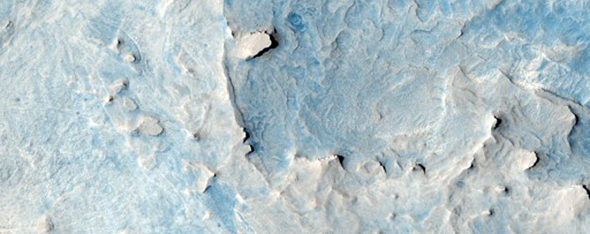 Curved Ridge Intersection with Light-Toned Material in West Arabia Terra