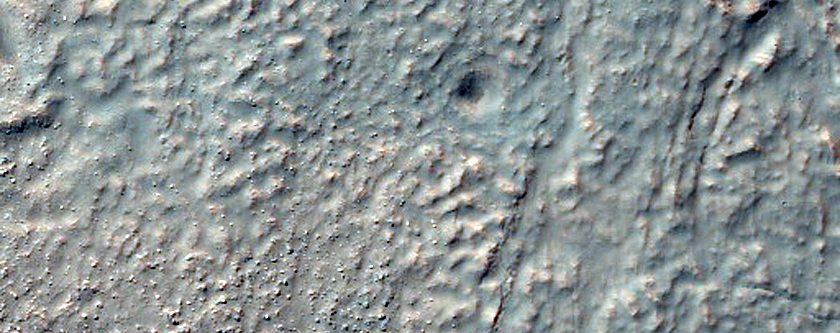 Inverted Channels and Fans on Southwest Rim of Kaiser Crater