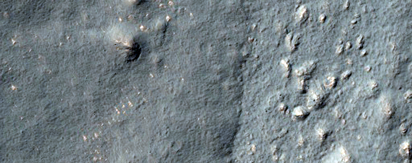 Tongue-Shaped Flow Feature and Clam-Shaped Feature in Hellas Montes Region