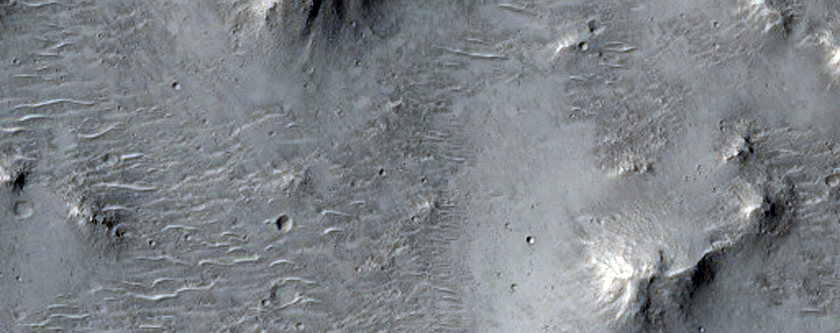 Polygonal Crater Fill Surrounded by Smooth Plains