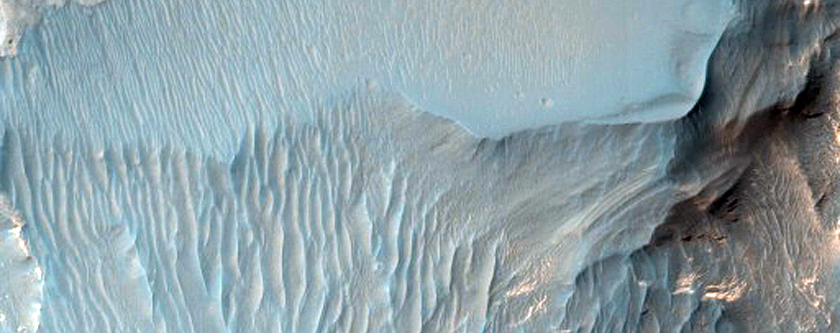 Ridges and Layered Deposits Near Capri Mensa