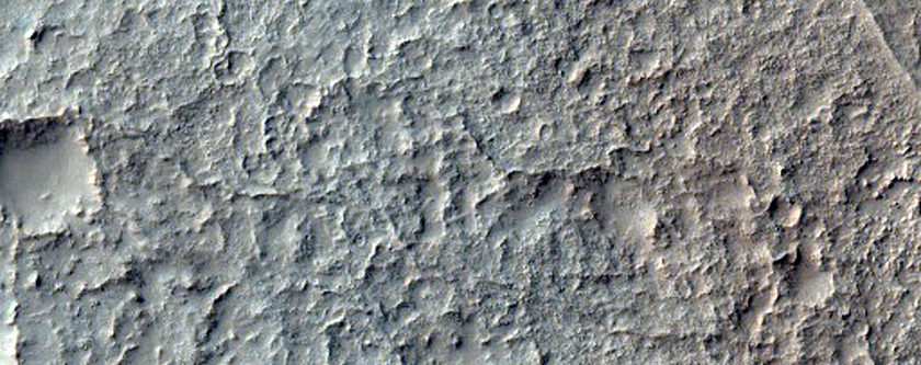 Pit on Crater Floor Which Exposes Layered Deposits