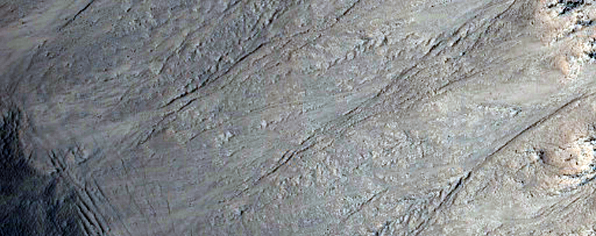 Spokes, Creep, and Channels in a Crater in Utopia Planitia